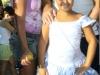 O bloco do Truquinho atraiu famílias na tarde de sol, no Centro da Vila.